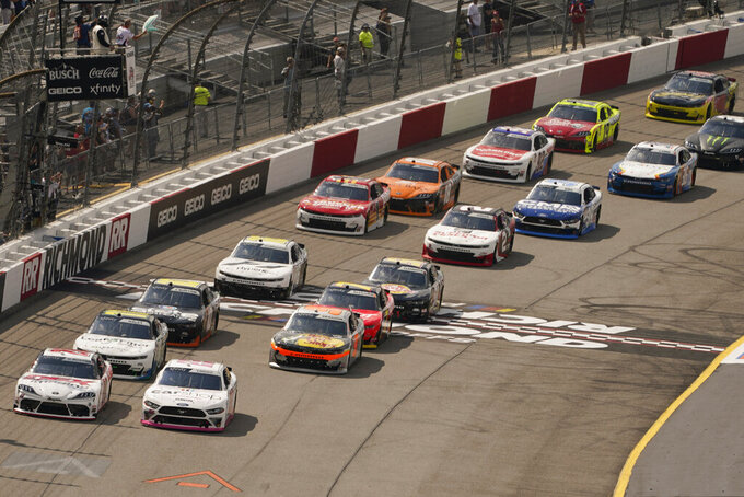 Harrison Burton (20) and Austin Cindric (22) lead the field at the start of the NASCAR Xfinity auto race in Richmond, Va., Saturday, Sept. 11, 2021. (AP Photo/Steve Helber)