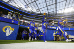 The Los Angeles Rams enter the field before a preseason NFL football game against the Los Angeles Chargers on Saturday, Aug. 14, 2021, in Inglewood, Calif. (AP Photo/Ringo Chiu)