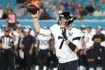 Jacksonville Jaguars quarterback Nick Foles passes during the first half of an NFL football preseason game against the Miami Dolphins, Thursday, Aug. 22, 2019, in Miami Gardens, Fla. (AP Photo/Wilfredo Lee)