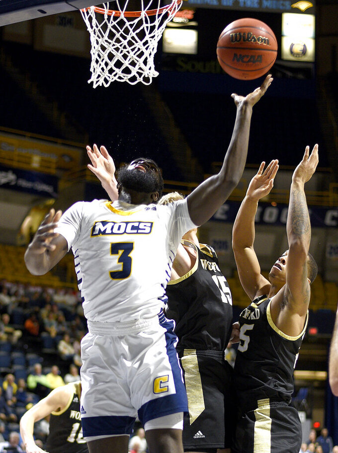 UTC's David Jean-Baptiste (3) splits two Terriers to score. The University of Tennessee Mocs hosted the Wofford Terriers in Southern Conference basketball at McKenzie Arena on January 15, 2020. (Robin Rudd/Chattanooga Times Free Press via AP)