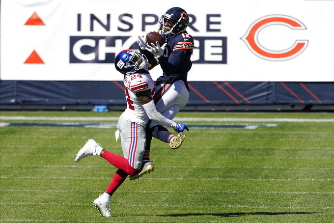 New York Giants cornerback James Bradberry (24) intercepts a pass from Chicago Bears wide receiver Allen Robinson (12) during the second half of an NFL football game in Chicago, Sunday, Sept. 20, 2020. (AP Photo/Charles Rex Arbogast)