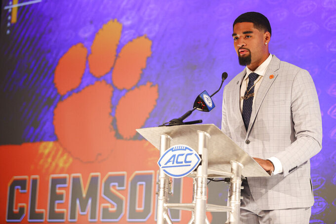 Clemson quarterback D.J. Uiagalelei answers a question during an NCAA college football news conference at the Atlantic Coast Conference media days in Charlotte, N.C., Thursday, July 22, 2021. (AP Photo/Nell Redmond)