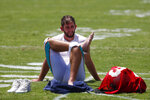 Miami Dolphins quarterback Josh Rosen stretches out while waiting to speak to members of the media after the teams NFL football training camp, Tuesday, July 30, 2019 in Davie, Fla. Coach Brian Flores says Ryan Fitzpatrick has become the front-runner in the Miami Dolphins' quarterback competition ahead of Rosen. (AP Photo/Wilfredo Lee)