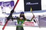 United States' Mikaela Shiffrin celebrates on the podium after winning an alpine ski, women's World Cup downhill, in Bansko, Bulgaria, Friday, Jan. 24, 2020. (AP Photo/Giovanni Auletta)