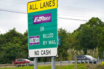 """Signs on the entrance ramp in Gibsonia, Pa., indicate to motorists the methods being used to collect tolls on the Pennsylvania Turnpike on Monday, Aug. 30, 2021. More than $104 million in Pennsylvania Turnpike tolls went uncollected last year as the agency fully converted to all-electronic tolling. Turnpike records show the millions of motorists who don't use E-ZPass have a nearly 1 in 2 chance of riding without paying under the """"toll-by-plate"""" license plate reader system.(AP Photo/Keith Srakocic)"""
