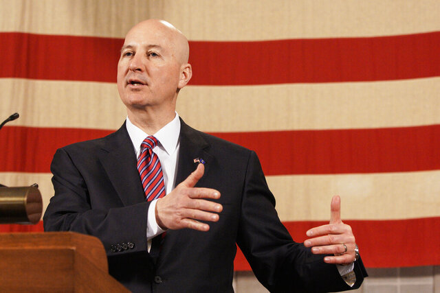 Nebraska Gov. Pete Ricketts speaks at a news conference in Lincoln, Neb., Thursday, April 2, 2020. Gov. Ricketts defended his refusal to issue a stay-at-home order for residents, arguing that it isn't necessary for Nebraska even though 40 other governors have done so to try to keep the new coronavirus from spreading. Ricketts said he doesn't plan to deviate from his current approach, which includes a statewide, non-enforceable recommendation that residents avoid gatherings with more than 10 people. (AP Photo/Nati Harnik)