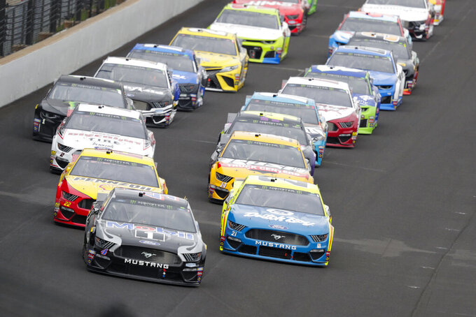 Kevin Harvick leads the field into the first turn on the start of the NASCAR Brickyard 400 auto race at Indianapolis Motor Speedway, Sunday, Sept. 8, 2019, in Indianapolis. (AP Photo/Michael Conroy)