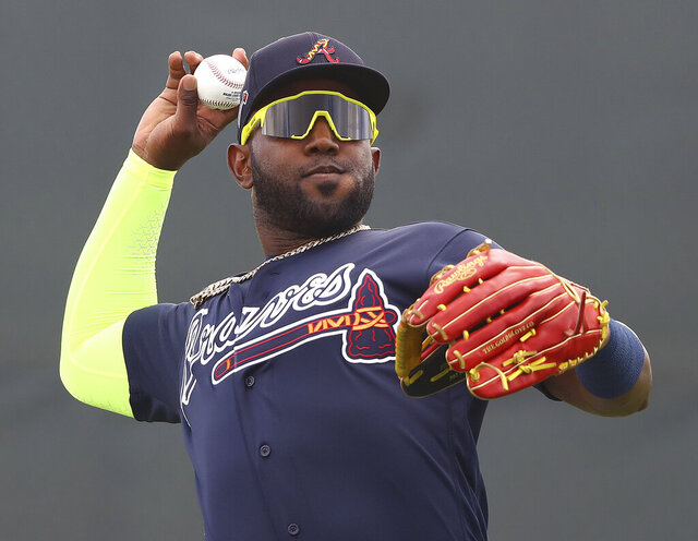 Atlanta Braves outfielder Marcell Ozuna fields a ball during spring training at CoolToday Park on Wednesday, Feb. 19, 2020, in North Port. (Curtis Compton/Atlanta Journal-Constitution via AP)