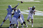 Wake Forest quarterback Sam Hartman (10) passes against North Carolina during the first half of an NCAA college football game in Chapel Hill, N.C., Saturday, Nov. 14, 2020. (AP Photo/Gerry Broome)