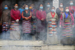 Friends and family members gather for the funeral of veteran Nepalese Sherpa guide Ang Rita, in Kathmandu, Nepal, Wednesday, Sept. 23, 2020. Ang Rita, who was the first person to climb Mount Everest 10 times has died Monday at age 72 after a long illness. (AP Photo/Niranjan Shrestha)