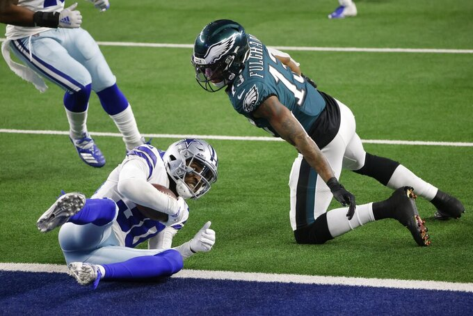 Dallas Cowboys cornerback Anthony Brown (30) intercepts a pass in the end zone intended for Philadelphia Eagles wide receiver Travis Fulgham (13) in the second half of an NFL football game in Arlington, Texas, Sunday, Dec. 27. 2020. (AP Photo/Michael Ainsworth)