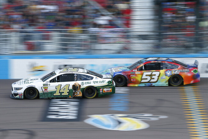Clint Bowyer (14) and JJ Yeley (53) during the NASCAR Cup Series auto race at ISM Raceway, Sunday, Nov. 10, 2019, in Avondale, Ariz. (AP Photo/Ralph Freso)