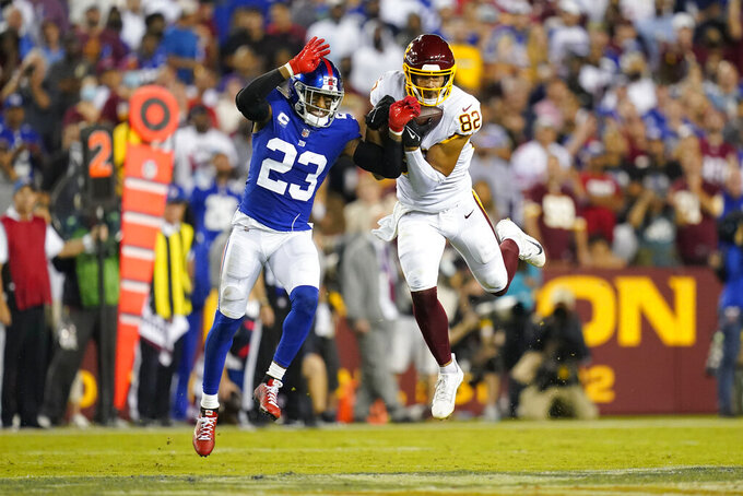 Washington Football Team tight end Logan Thomas (82) makes a catch for a first down against New York Giants cornerback Logan Ryan (23) during the first half of an NFL football game, Thursday, Sept. 16, 2021, in Landover, Md. (AP Photo/Patrick Semansky)