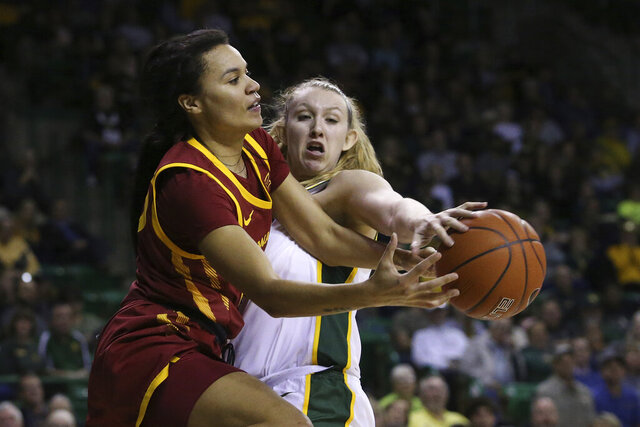 Iowa State forward Kristin Scott (25) and Baylor forward Lauren Cox (15) reach for the loose ball during the first half of an NCAA college basketball game Tuesday, Jan. 28, 2020, in Waco, Texas. (AP Photo/Jerry Larson)