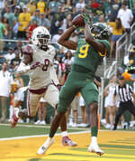 Baylor wide receiver Tyquan Thornton (9) catches a pass for a touchdown against Texas Southern defensive back Ja'Corey Benjamin (8) in the first half of an NCAA college football game, Saturday, Sept. 11, 2021, in Waco, Texas. (Jerry Larson/Waco Tribune-Herald via AP)