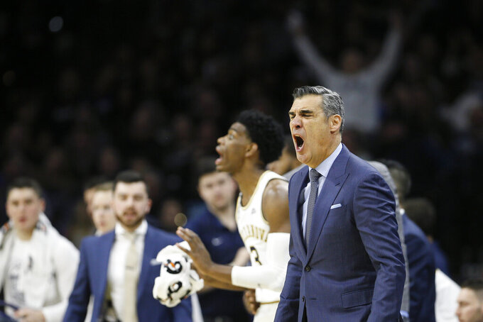Villanova head coach Jay Wright yells to his team during the second half of an NCAA college basketball game against Kansas, Saturday, Dec. 21, 2019, in Philadelphia. (AP Photo/Matt Slocum)