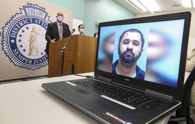Salt Lake County District Attorney Sim Gill, left, announces aggravated murder charges against Adam Antonio Spencer Durborow, 29, pictured on computer screen, in the 2010 death of Sherry Black during a news conference at the district attorney's office in Salt Lake City on Monday, Oct. 26, 2020. Gill was joined at the event by other officials involved in the case. (Steve Griffin/The Deseret News via AP)