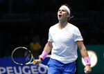 Spain's Rafael Nadal celebrates after defeating Stefanos Tsitsipas of Greece in their ATP World Tours Finals singles tennis match at the O2 Arena in London, Friday, Nov. 15, 2019. (AP Photo/Alastair Grant)