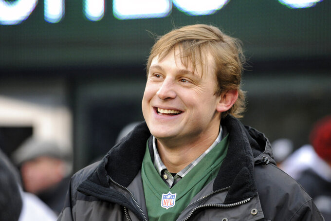 FILE - In this Dec. 8, 2013, file photo, former New York Jets quarterback Chad Pennington smiles before the team's NFL football game against the Oakland Raiders in East Rutherford, N.J. Pennington, the NFL's Comeback Player of the Year for the Jets in 2006 and for the Dolphins in 2008, is a member of the league's Legends Youth Advisory Committee, which was launched earlier this year. It guides efforts to grow youth and high school football. (AP Photo/Bill Kostroun, File)