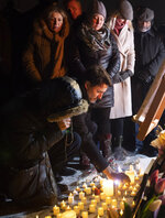 Canadian Prime Minister Justin Trudeau participates in a candle light vigil for victims of the Ukraine International Airlines plane crash, Thursday, Jan. 9, 2020, in Ottawa, Ontario. The civilian Ukrainian jetliner crashed near Tehran late Tuesday, killing all 176 people on board. (Adrian Wyld/The Canadian Press via AP)