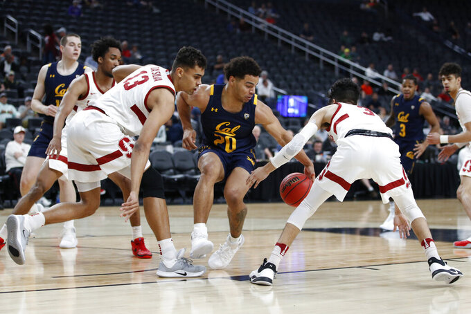 California's Matt Bradley (20) drives between Stanford's Oscar da Silva (13) and Tyrell Terry (3) during the first half of an NCAA college basketball game in the first round of the Pac-12 men's tournament Wednesday, March 11, 2020, in Las Vegas. (AP Photo/John Locher)