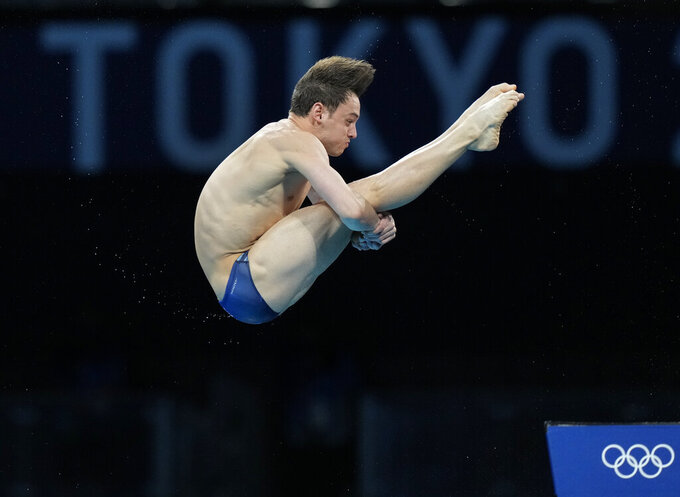 Thomas Daley of Great Britain competes in men's diving 10m platform semifinal at the Tokyo Aquatics Centre at the 2020 Summer Olympics, Saturday, Aug. 7, 2021, in Tokyo, Japan. (AP Photo/Dmitri Lovetsky)