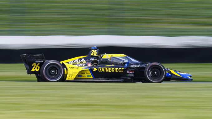 Colton Herta drives during practice for the IndyCar auto race at Indianapolis Motor Speedway in Indianapolis, Friday, May 14, 2021. (AP Photo/Michael Conroy)