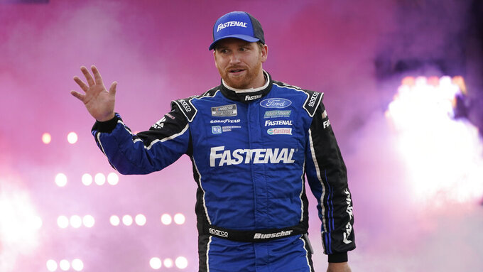 Chris Buescher waves to the crowd during driver introductions prior to the start of the NASCAR Cup series auto race in Richmond, Va., Saturday, Sept. 11, 2021. (AP Photo/Steve Helber)