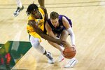 Baylor guard Davion Mitchell, left, attempts to steal the ball away from Stephen F. Austin guard David Kachelries during the first half of an NCAA college basketball game in Waco, Texas, Wednesday, Dec. 9, 2020. (AP Photo/Tony Gutierrez)