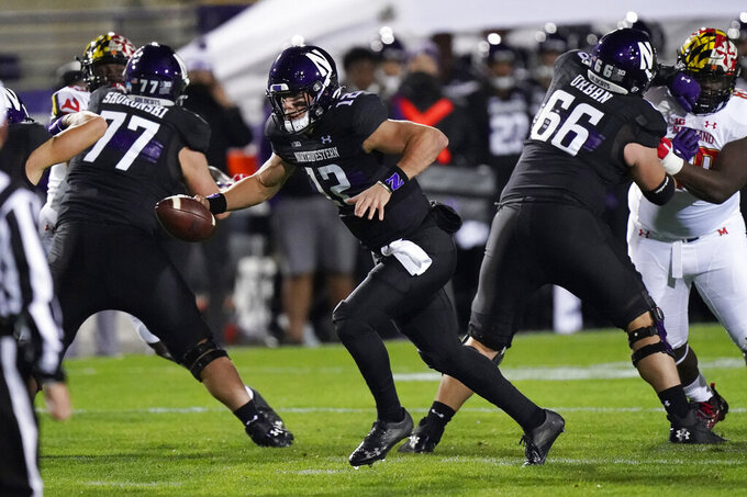 Northwestern quarterback Peyton Ramsey runs with the ball during the first half of an NCAA college football game against Maryland in Evanston, Ill., Saturday, Oct. 24, 2020. (AP Photo/Nam Y. Huh)