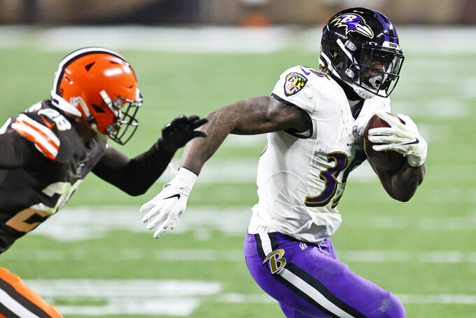 Baltimore Ravens running back Gus Edwards (35) rushes for a 35-yard touchdown during the second half of an NFL football game against the Cleveland Browns, Monday, Dec. 14, 2020, in Cleveland. (AP Photo/Ron Schwane)