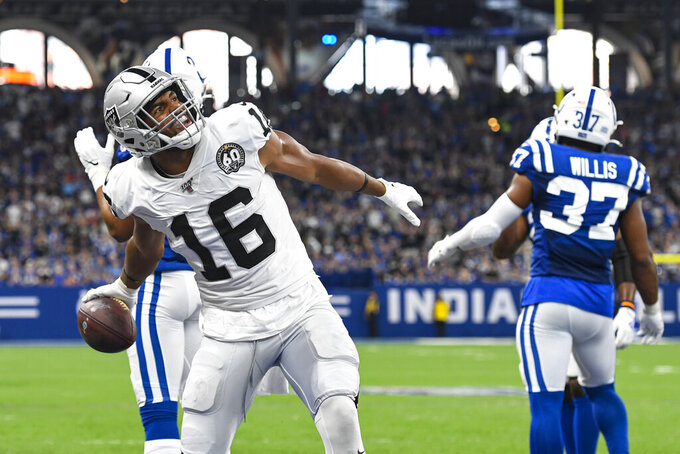 Oakland Raiders wide receiver Tyrell Williams (16) celebrates his touchdown against the Indianapolis Colts during the first half of an NFL football game in Indianapolis, Sunday, Sept. 29, 2019. (AP Photo/Doug McSchooler)