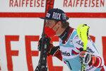 Austria's Manuel Feller celebrates winning an alpine ski, men's World Cup slalom, in Lenzerheide, Switzerland, Sunday, March 21, 2021. (AP Photo/Marco Trovati)