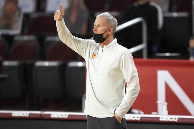 Southern California coach Andy Enfield gestures during the first half of the team's NCAA college basketball game against Stanford on Wednesday, March 3, 2021, in Los Angeles. (AP Photo/Kyusung Gong)