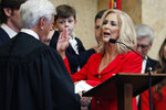 Attorney General Lynn Fitch recites the oath of office as administered by Mississippi Supreme Court Chief Justice Michael Randolph, left, in House chambers at the Mississippi Capitol in Jackson, Miss., Thursday, Jan. 9, 2020. (AP Photo/Rogelio V. Solis)