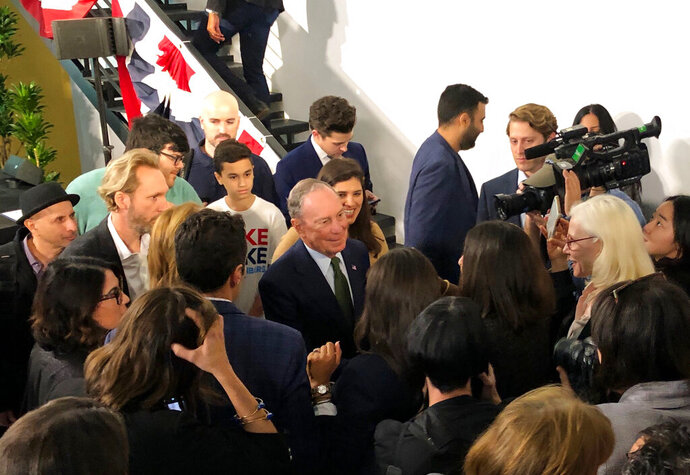 Democratic presidential candidate Michael Bloomberg greets supporters, staff and media at the opening of his downtown Los Angeles headquarters on Monday, Jan. 6, 2020. The Democratic presidential candidate and former New York City mayor likes a lot of what he sees in the Golden State and thinks its efforts on climate change, gun control and criminal justice reform sets a benchmark for other states to emulate. (AP Photo/Michael R. Blood)