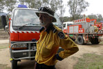 Volunteer firefighter John Nightingale talks about their planned defense against the fire near Towamba, Australia, Friday, Jan. 10, 2020. The wildfires have destroyed more than 2,000 homes and continue to burn, threatening to flare up again as temperatures rise. (AP Photo/Rick Rycroft)