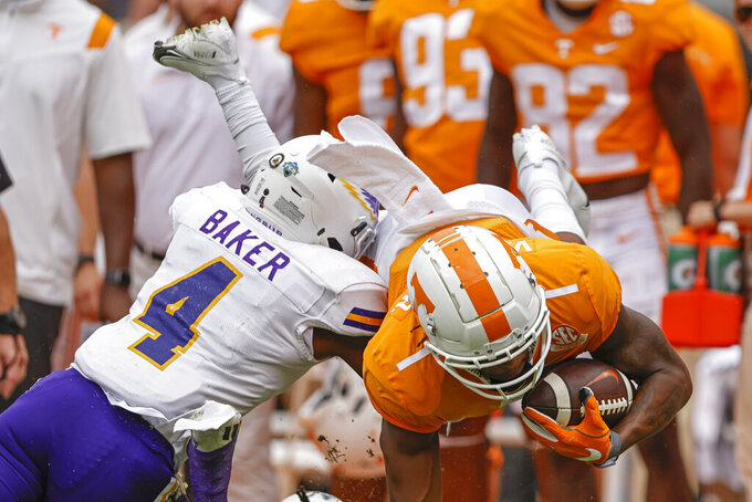 Tennessee wide receiver Velus Jones Jr. (1) is upended as he's hit by Tennessee Tech defensive back Jalon Baker (4) during the second half of an NCAA college football game Saturday, Sept. 18, 2021, in Knoxville, Tenn. Tennessee won 56-0. (AP Photo/Wade Payne)