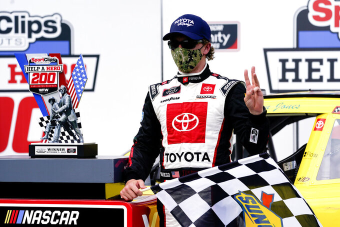 Brandon Jones (19) poses for a photo after winning the NASCAR Xfinity Series auto race Saturday, Sept. 5, 2020, in Darlington, S.C. (AP Photo/Chris Carlson)