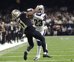 FILE - In this Jan. 20, 2019, file photo, Los Angeles Rams' Nickell Robey-Coleman breaks up a pass intended for New Orleans Saints' Tommylee Lewis during the second half of the NFL football NFC championship game, in New Orleans.  Jacksonville Jaguars defensive end Calais Campbell watched the NFL's conference championship games on his phone while flying home from South Africa last weekend. Campbell was stunned officials chose not to penalize Robey-Coleman for flattening Saints receiver Tommylee Lewis before the ball arrived. (AP Photo/Gerald Herbert, File)