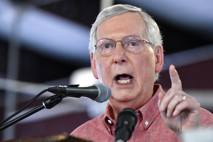 In this Saturday, Aug. 3, 2019 photo, Senate Majority Leader Mitch McConnell, R-Ky., addresses the audience gathered at the Fancy Farm Picnic in Fancy Farm, Ky. A spokesman for Mitch McConnell says the Senate majority leader tripped outside his home in Kentucky and suffered a shoulder fracture. McConnell fell on his outdoor patio, but has been treated and released after getting medical attention. (AP Photo/Timothy D. Easley)