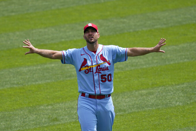 St. Louis Cardinals starting pitcher Adam Wainwright stretches in right field before a baseball game against the Chicago White Sox Saturday, Aug. 15, 2020, in Chicago. (AP Photo/Charles Rex Arbogast)