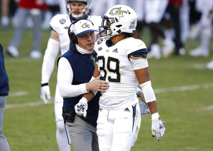 Georgia Tech head coach Geoff Collins talks to defensive back Wesley Walker (39) during an NCAA college football game against N.C. State in Raleigh, N.C., Saturday, Dec. 5, 2020. (Ethan Hyman/The News & Observer via AP, Pool)
