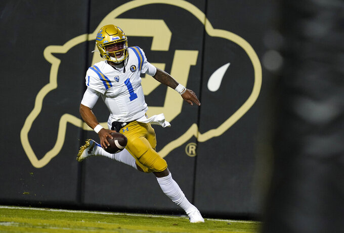 UCLA quarterback Dorian Thompson-Robinson runs for a touchdown against Colorado in the second half of an NCAA college football game Saturday, Nov. 7, 2020, in Boulder, Colo. (AP Photo/David Zalubowski)