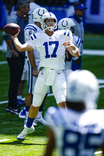 Indianapolis Colts quarterback Philip Rivers (17) throws during practice at the NFL team's football training camp at Lucas Oil Stadium in Indianapolis, Monday, Aug. 24, 2020. (AP Photo/Michael Conroy)