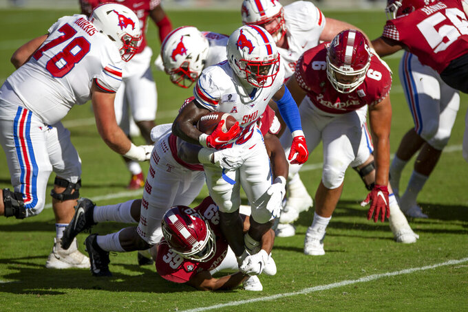 SMU running back Ulysses Bentley IV (26) is tackled by Temple linebacker George Reid (39) in the first half of an NCAA college football game, Saturday, Nov. 7, 2020, in Philadelphia. (AP Photo/Laurence Kesterson)
