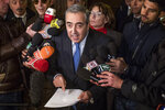 Maurizio Gasparri, president of the Senate commission on parliamentary immunity talks to reporters after the commission voted to lift immunity to Lega party leader Matteo Salvini to put him on trial for alleged kidnapping for keeping migrants aboard a rescue ship when he was interior minister, in Rome, Monday, Jan. 20, 2020. Salvini insists he acted to safeguard Italy's borders when he refused for six days to allow the coast guard ship Gregoretti bring 131 rescued migrants ashore to Sicily in July 2019.  (Roberto Monaldo/LaPresse via AP)