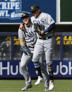 Tampa Bay Rays left fielder Austin Meadows, left, and right fielder Avisail Garcia celebrate after defeating the New York Yankees 2-1 in 11 innings in a baseball game, Saturday, May 18, 2019, in New York. (AP Photo/Jim McIsaac)