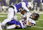 James Madison safety D'Angelo Amos (24) strips the ball away from Northern Iowa running back Tyler Hoosman (32) for a fumble during the first half of a quarterfinal game in the NCAA college Football Championship Subdivision playoffs in Harrisonburg, Va., Friday, Dec. 13, 2019. (Daniel Lin/Daily News-Record via AP)
