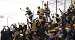 Boston Bruins right wing David Pastrnak, left, raises his stick while celebrating with fans after his second goal against the Columbus Blue Jackets during the third period of Game 5 of an NHL hockey second-round playoff series, Saturday, May 4, 2019, in Boston. (AP Photo/Charles Krupa)